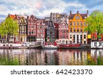 Stock photo amsterdam netherlands dancing houses over river amstel landmark in old european city spring 642423370