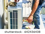 air conditioning technician and ... | Shutterstock . vector #642436438