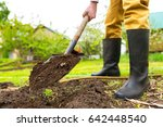 a farmer is digging soil with a ... | Shutterstock . vector #642448540