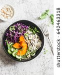Small photo of Wild rice, roasted pumpkin, red cabbage buddha bowl. Vegetarian food concept. On a light background, top view