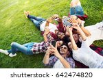 group of young people laying on ... | Shutterstock . vector #642474820