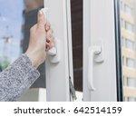 woman's hand opening a window....   Shutterstock . vector #642514159