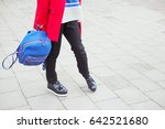 woman in a bright red coat with ... | Shutterstock . vector #642521680