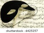 Sheetmusic With A Black Mask  ...