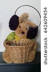 Small photo of Rabbit hamper with earmuff/ Easter gift received years ago and now decorated with winter earmuffs