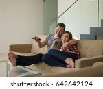 young couple on the sofa... | Shutterstock . vector #642642124