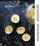 Small photo of Salt Crackers with ajwain and sesame seeds with glass jar. Overhead View