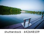 pier for boats on the lake | Shutterstock . vector #642648109