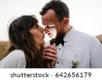 bride and groom making a funny... | Shutterstock . vector #642656179