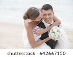 groom giving piggyback ride to... | Shutterstock . vector #642667150