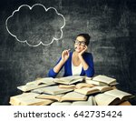 books and thinking woman ... | Shutterstock . vector #642735424