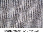 Small photo of close-up of gray knitted acrylic fiber sweater texture, vertical thread patterns