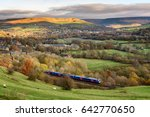 passenger train passing through ... | Shutterstock . vector #642770650