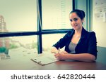 business woman sit and write on ... | Shutterstock . vector #642820444