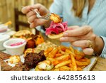 view of hands of people eating... | Shutterstock . vector #642855613