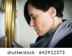 woman looking at picture ...   Shutterstock . vector #642912373