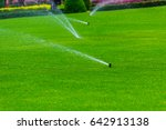 lawn sprinkler spaying water...