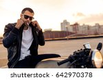 handsome happy rider man with... | Shutterstock . vector #642970378