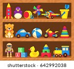 kids toys on wood shop shelves. ... | Shutterstock . vector #642992038