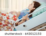 mother giving birth to baby.... | Shutterstock . vector #643012153