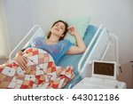 Small photo of Mother giving birth to baby. Pregnant patient in a hospital