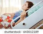 mother giving birth to baby.... | Shutterstock . vector #643012189