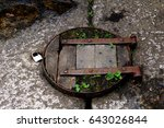 Small photo of Old rustic wooden trap door with padlock