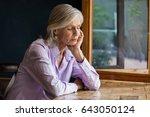 sad senior woman sitting at... | Shutterstock . vector #643050124