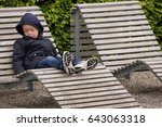 COPENHAGEN, DENMARK - MAY, 07, 2017: A boy sleeping on a chaise lounge in nature - stock photo