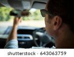 close up of man adjusting... | Shutterstock . vector #643063759