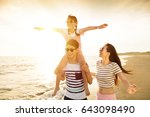 happy family playing on the... | Shutterstock . vector #643098490