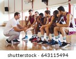coach explaining game plan to... | Shutterstock . vector #643115494
