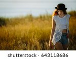young pretty woman wearing hat... | Shutterstock . vector #643118686