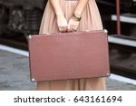suitcase in hands | Shutterstock . vector #643161694