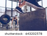 Small photo of Close-up partial view of sporty people exercising at cross fit gym workout