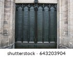 Small photo of Door of the All Saints church in Wittenberg Germany with the ninety-five theses posted by Martin Luther