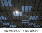 solar panel under the sun rays. | Shutterstock . vector #643213684