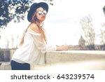 beautiful young woman outdoors... | Shutterstock . vector #643239574