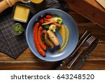 grilled sausages on wooden... | Shutterstock . vector #643248520