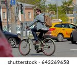 a cyclist on the road in the... | Shutterstock . vector #643269658