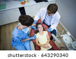 dentists examining a young... | Shutterstock . vector #643290340