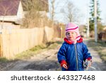 a child walks on the street out ... | Shutterstock . vector #643327468