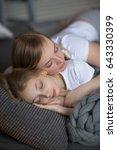 mum embraces a sleeping... | Shutterstock . vector #643330399