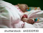 sleeping boy with two soothers. | Shutterstock . vector #643333930