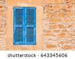 blue wooden shutters with... | Shutterstock . vector #643345606