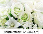 Stock photo close up beautiful white rose and flowers on vase in soft focus concept 643368574