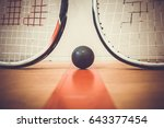 Squash Ball Between Two Squash...