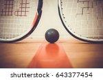 Squash Ball Between Two Squash...
