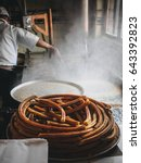 cooking of churros. ring of... | Shutterstock . vector #643392823