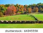 Fertile Farmland and hay bales in beautiful fall colors - stock photo